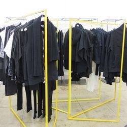 Sleek, drapey duds in black, black and more black.