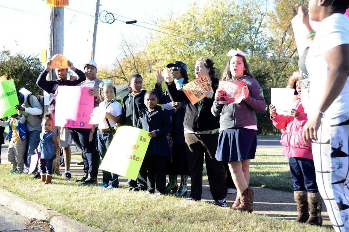 Students and parents line the street in November to protest the proposed takeover of Sheffield Elementary School by the Achievement School. The state-run district later removed the Memphis school from its takeover list for 2016-17.