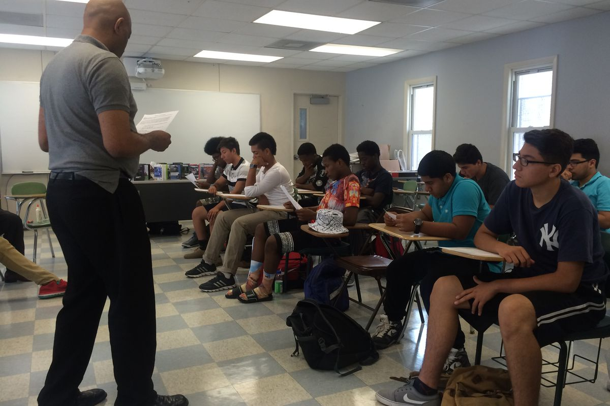 Students in Urban Ambassadors work together to prepare for a class debate on Common Core.