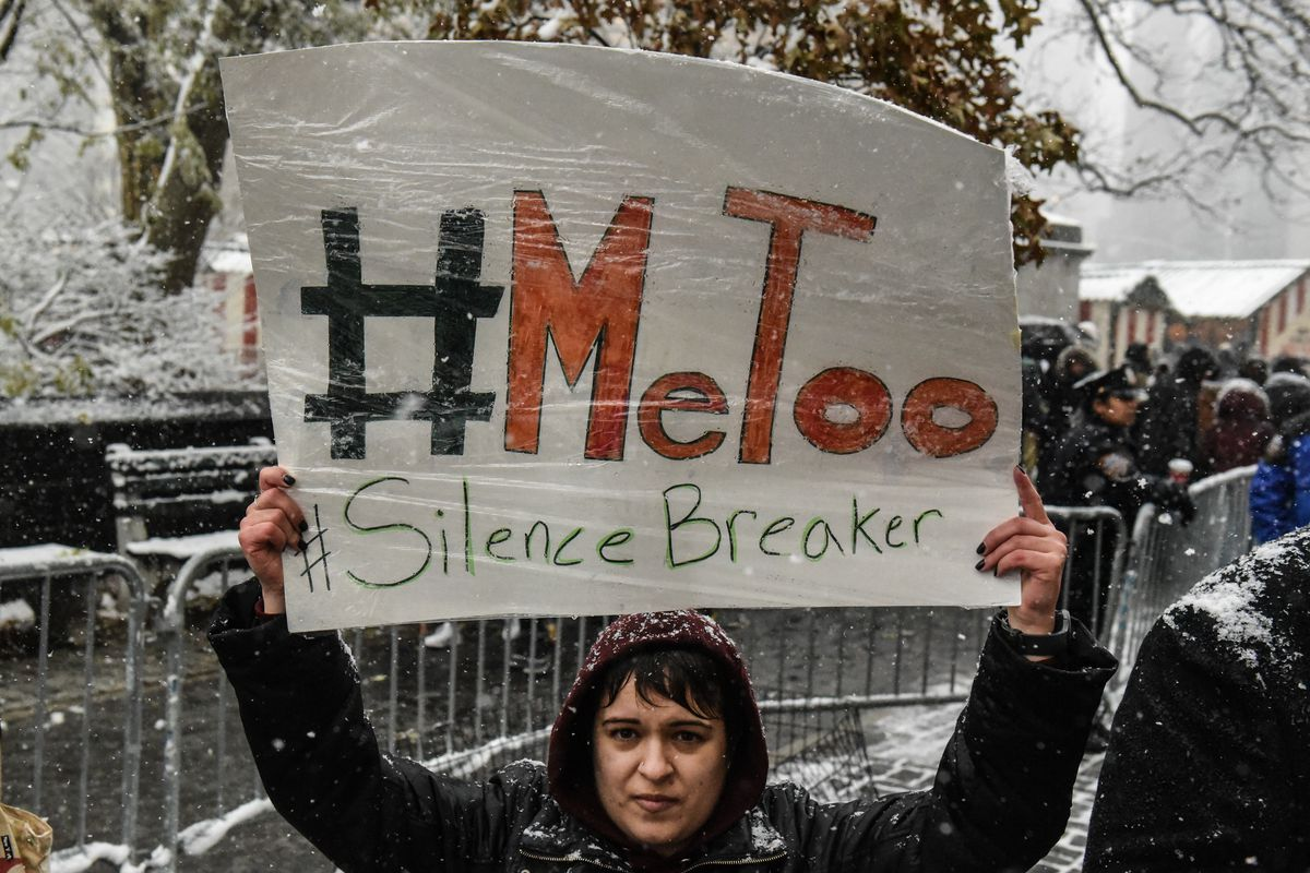 A demonstrator at a #MeToo rally outside of Trump Tower in New York City on December 9