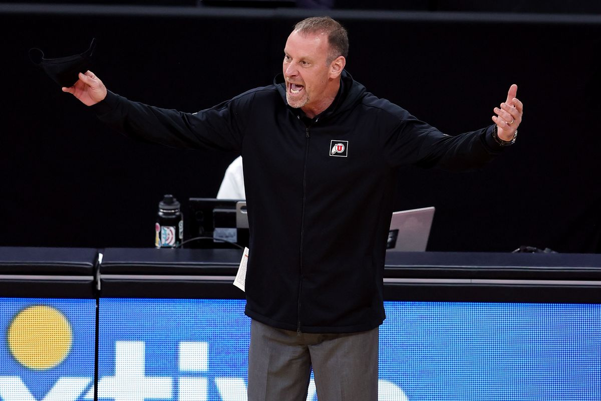 Utah Utes head coach Larry Krystkowiak yells a question to a referee as Utah and USC play in the Pac-12 Tournament at T-Mobile Arena in Las Vegas on Thursday, March 11, 2021.