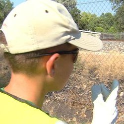 Matthew Mancil points to the area where a Union Pacific train came to a stop in Clinton, Thursday, July 17, 2014. The conductor came out and gave him sunglasses, gloves, vest and lantern, all with the Union Pacific logos.