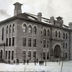 """""""During the early 1970s, the Men's Gym was used at times as living quarters for missionaries. The Gym is in the Training Building of the old Brigham Young Academy campus, located between 500 and 600 North on the east side of University Avenue."""" — This is the caption information found on the frame plaque accompanying this photo, one of nearly a dozen historical photos showing the development of the Language Training Mission and Missionary Training Center facilities in Provo since the 1960s."""