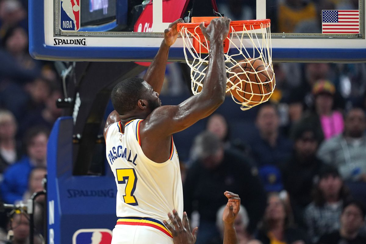Golden State Warriors forward Eric Paschall dunks during the second quarter against the Houston Rockets at Chase Center.