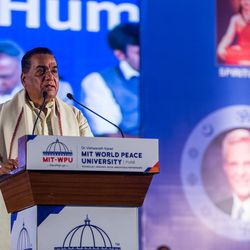 Prof. Dr. Vishwanath D. Karad, right, president of the World Peace Centre (Alandi), MAEER's MIT World Peace University, gives a speech during the award ceremony at MIT World Peace University,  Pune, Maharashtra, India on August 14, 2017.
