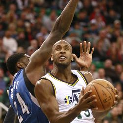 Utah Jazz guard Patrick Christopher goes for a lay up while being guarded by Minnesota Timberwolves forward Anthony Bennett during the game in the Energy Solutions Arena Tuesday, Dec. 30, 2014, in Salt Lake City.