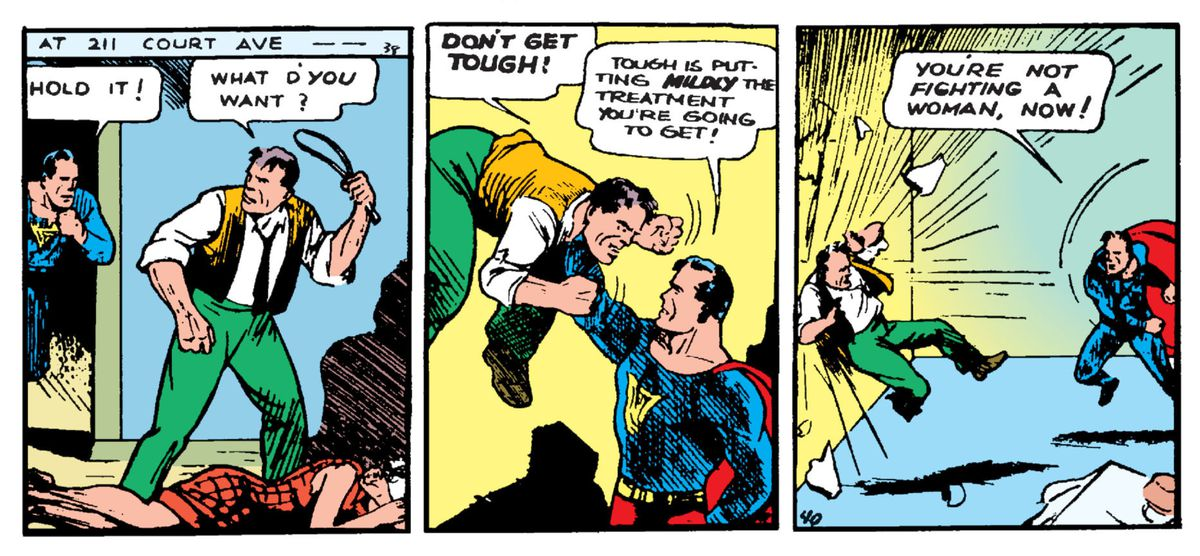 """Superman bursts into an apartment where a man is beating his wife with a belt, lifts him with one hand, and tosses him into the wall. """"You're not fighting a woman, now!"""" he declares, in Action Comics #1, DC Comics (1938)."""