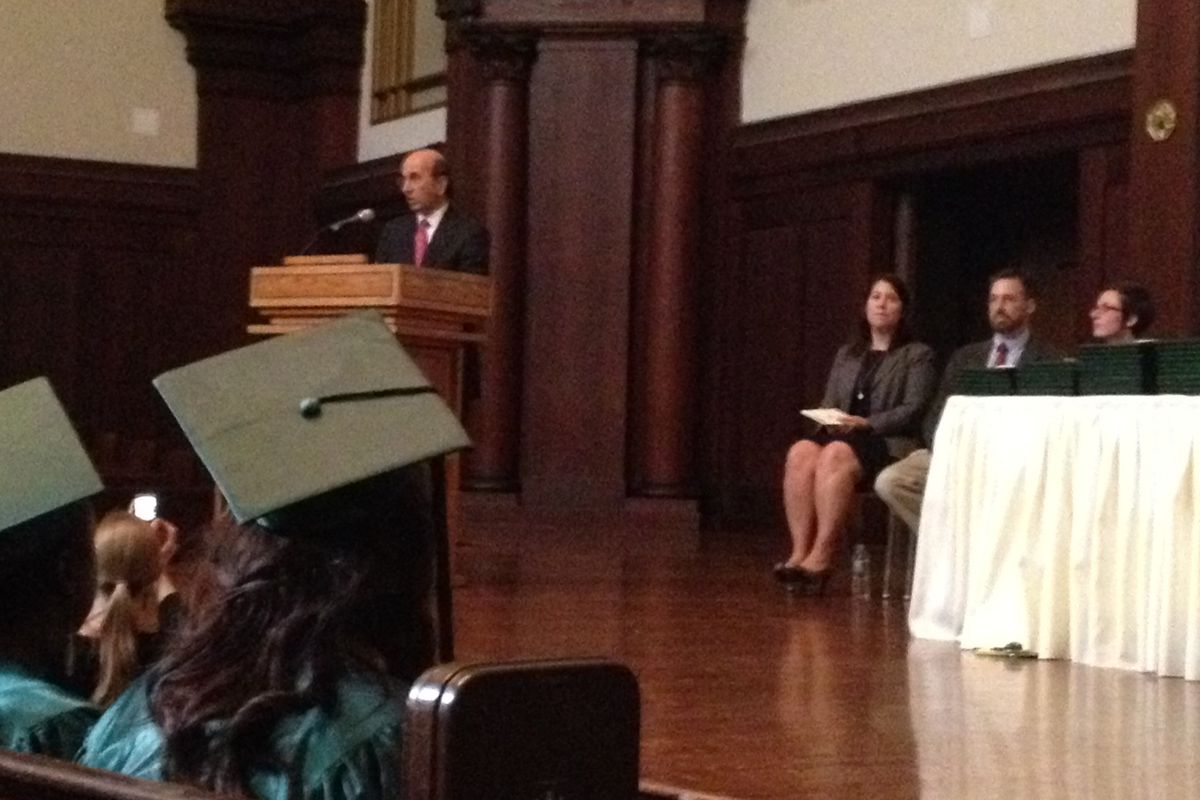 Former Schools Chancellor Joel Klein speaks at iSchool's graduation on Monday. Principal Alisa Berger is on the stage to Klein's right.