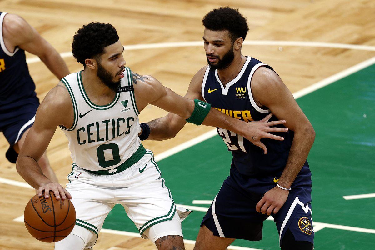 Jamal Murray #27 of the Denver Nuggets defends Jayson Tatum #0 of the Boston Celtics during the fourth quarter at TD Garden on February 16, 2021 in Boston, Massachusetts.