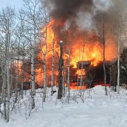 Flames engulf a house in Summit Park on Wednesday, Jan. 13, 2016.