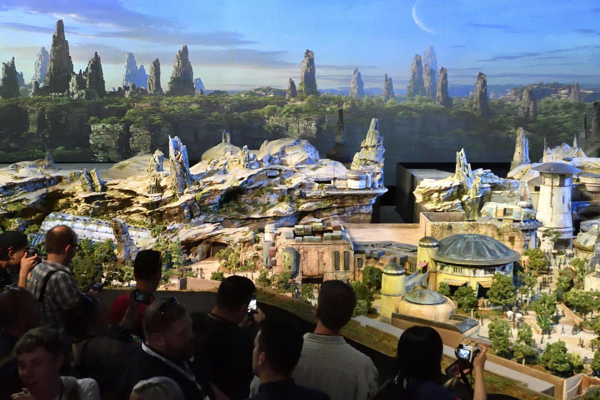 """Members of the media get their first look at a 50-foot, detailed model of """"Star Wars"""" land during a media preview for Disney's D23 Expo in Anaheim, Calf., on Thursday, July 13, 2017."""