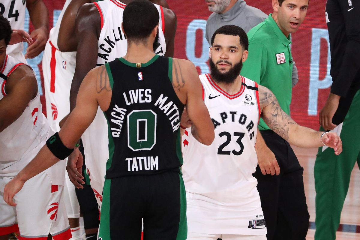 Jayson Tatum of the Boston Celtics and Fred VanVleet of the Toronto Raptors hug after the game in which the Boston Celtics won in Game Seven of the Eastern Conference Second Round during the 2020 NBA Playoffs at AdventHealth Arena at the ESPN Wide World Of Sports Complex on September 11, 2020 in Lake Buena Vista, Florida.