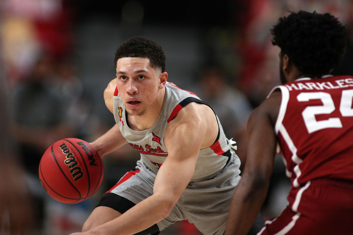Texas Tech Red Raiders guard Clarence Nadolny works the ball against Oklahoma Sooners guard Elijah Harkless in the second half at United Supermarkets Arena.