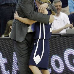 Brigham Young Cougars guard Haley Steed (33) hugs coach Jeff Judkins as they celebrate  winning  in the West Coast Conference finals in Las Vegas  Monday, March 5, 2012.