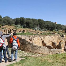 In this March 10, 2012 photo, Moroccan students on a school trip visit the Roman ruins of Sala Colonia outside the capital Rabat.
