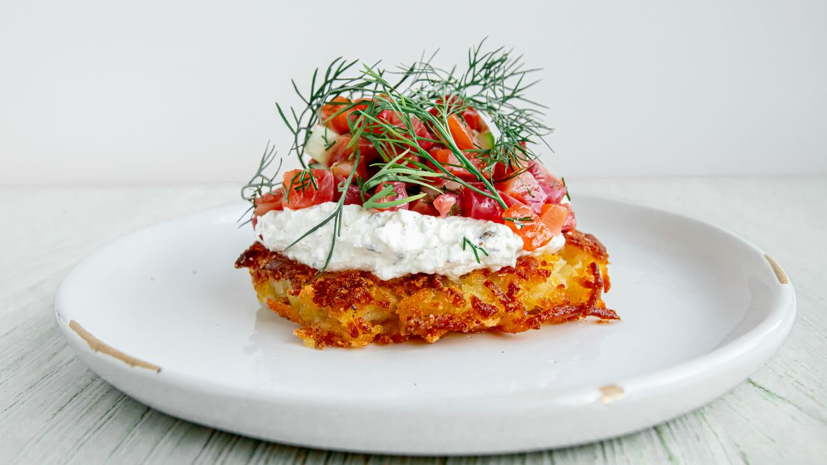 A cured arctic char rosti approximates lox and schmear with the addition of cucumber, a lemon dill vinaigrette, and a caraway quark that Anderson compares to a German ricotta.