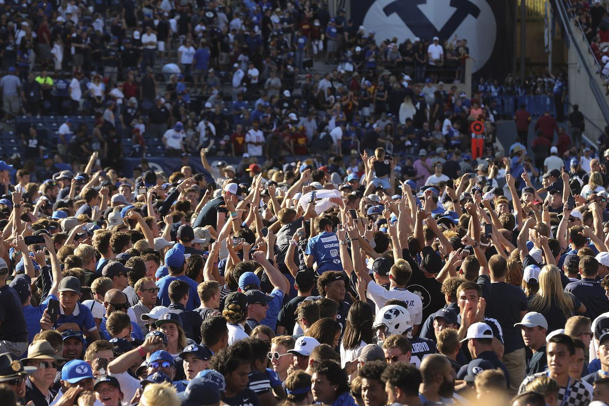 BYU fans storm the field after BYU beat USC in Provo on Saturday, Sept. 14, 2019. BYU won 30-27 in overtime.