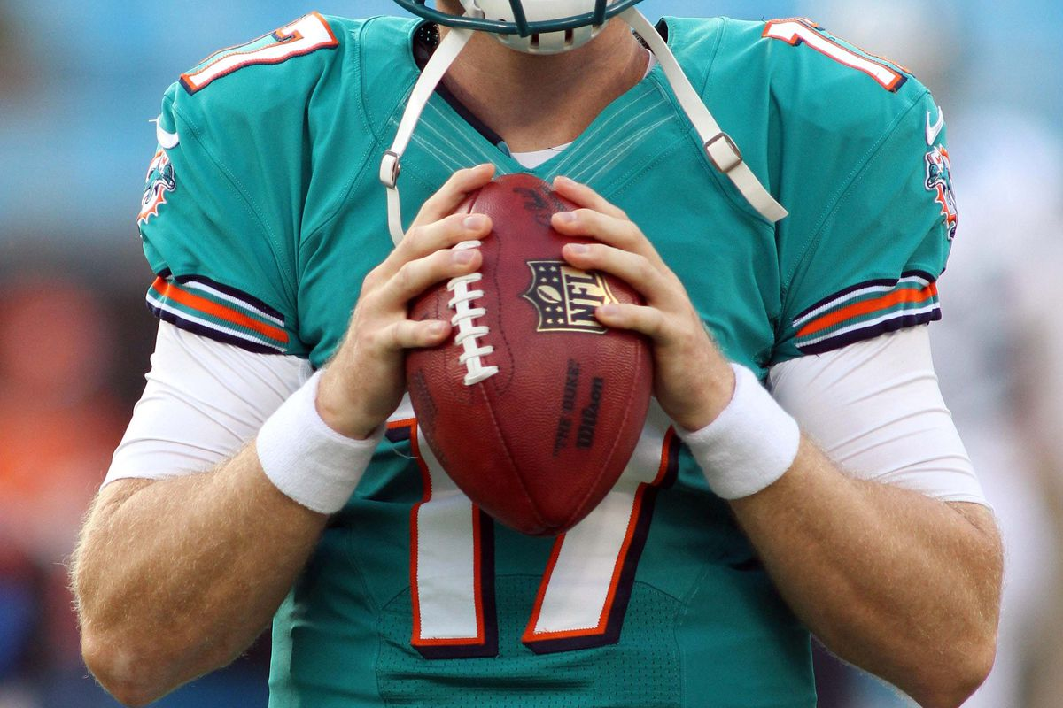 Aug 17, 2012; Charlotte, NC, USA; Miami Dolphins quarterback Ryan Tannehill (17) warms up before the start of the game against the Carolina Panthers at Bank of America Stadium. Mandatory Credit: Jeremy Brevard-US PRESSWIRE