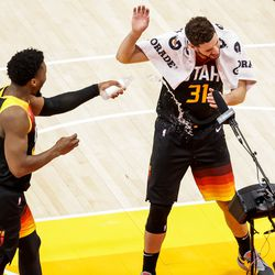 Utah Jazz guard Donovan Mitchell (45) splashes forward Georges Niang (31) with water after their win over the against the Oklahoma City Thunder at Vivint Smart Home Arena in Salt Lake City on Tuesday, April 13, 2021.