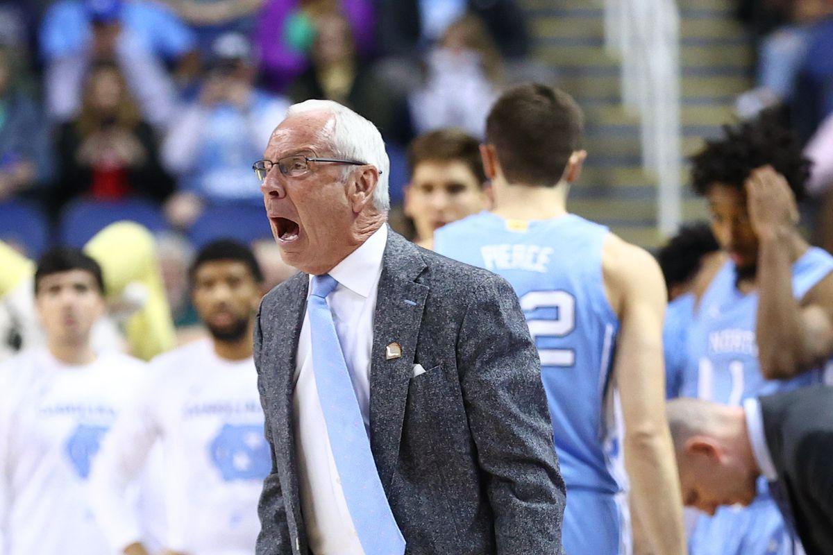 Greensboro, North Carolina, USA; North Carolina Tar Heels head coach Roy Williams reacts after a foul in the first half against the Syracuse Orange at Greensboro Coliseum.