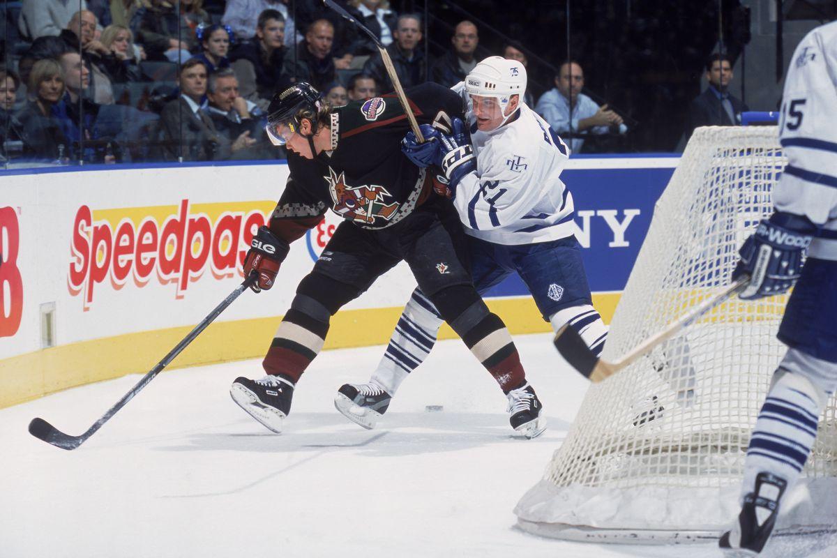 Robert Reichel #21 of the Toronto Maple Leafs checks Ladislav Nagy
