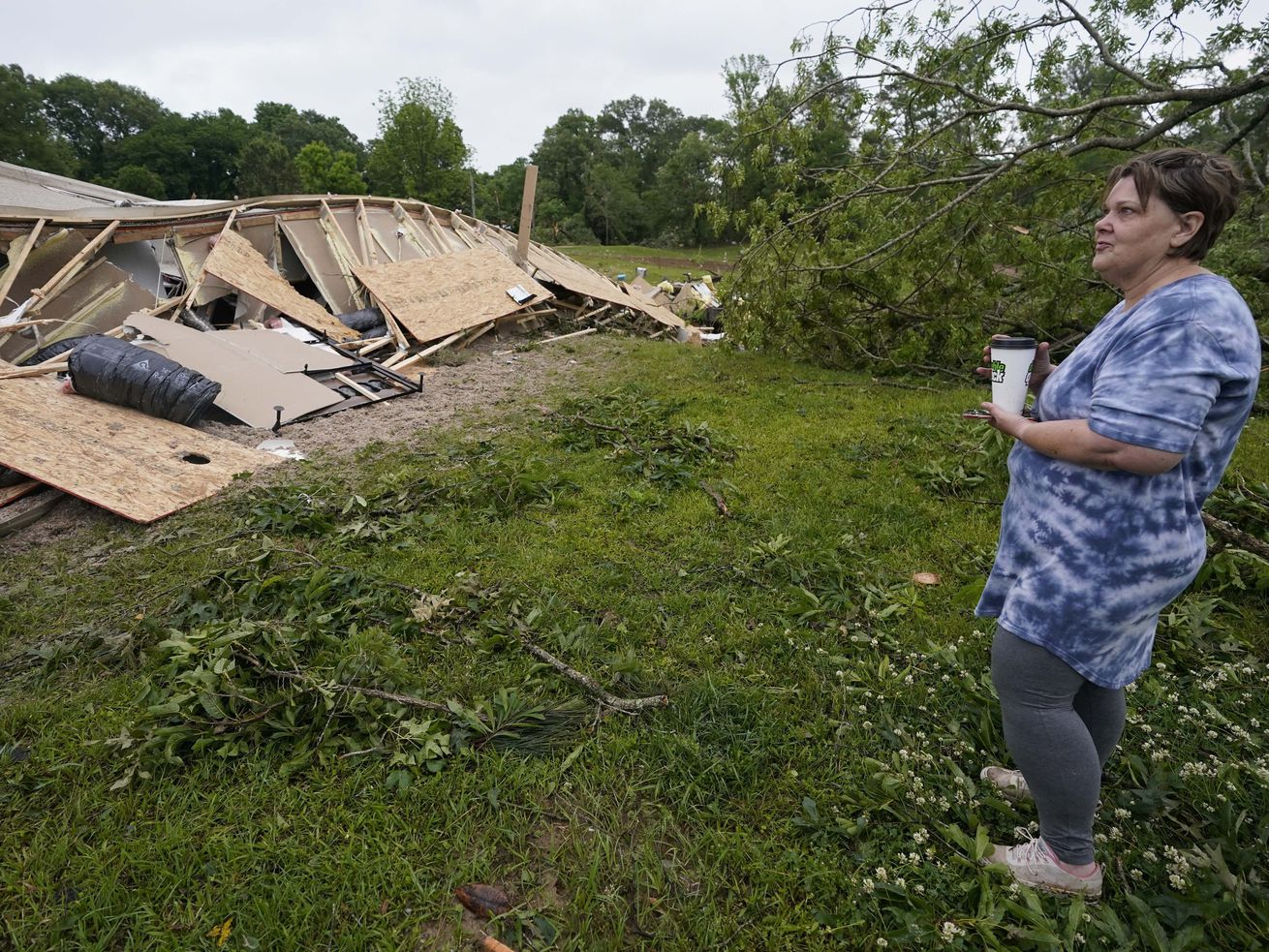 Vickie Savell looks at the remains of her new mobile home early Monday, May 3, 2021, in Yazoo County, Miss. Multiple tornadoes were reported across Mississippi on Sunday, causing some damage but no immediate word of injuries.
