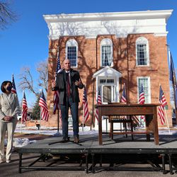 Utah Gov. Spencer Cox and Lt. Gov. Deidre Henderson make a stop at the Territorial State House in Fillmore as they make their way toward Salt Lake City after the inaugural ceremony earlier in the day at Tuacahn Center for the Arts in Ivins near St. George on Monday, Jan. 4, 2021. In Fillmore, Cox signed the Utah Compact on Racial Equity, Diversity and Inclusion. He also signed his first executive order requiring all state agencies to review all occupational licenses to remove unnecessary barriers and limit unnecessary government regulation and submit recommendations by June 30.
