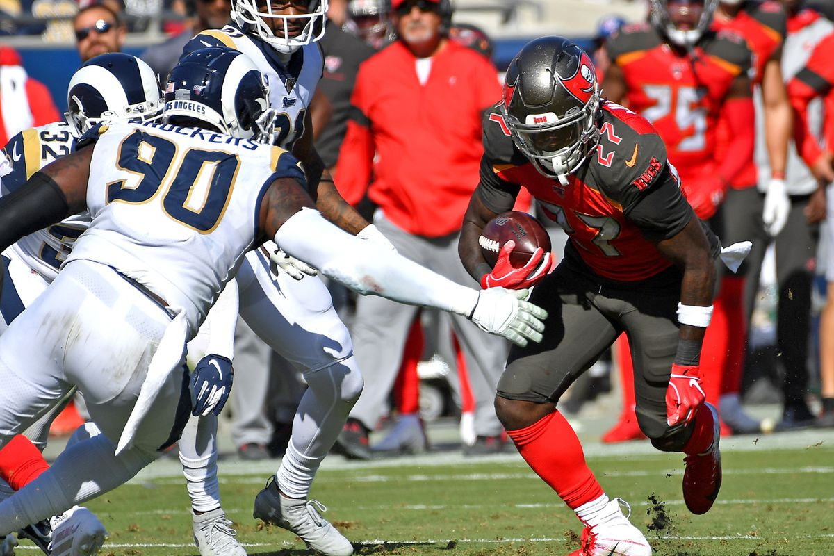 Los Angeles Rams defensive end Michael Brockers reaches to stop Tampa Bay Buccaneers running back Ronald Jones as he runs the ball in the second half at the Los Angeles Memorial Coliseum.