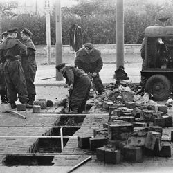 In this Aug 13, 1961 b/w file picture members of the East German military  remove paving blocks on Friedrich  Strasse in East Berlin  August 13, 1961 as  East Germany tightened the border crossing, between East and West Berlin. AP Photographer Peter Hillebrecht was on assignment in Berlin as the construction of the Berlin Wall starts on Aug. 13, 1961 and he was one of the first photographers to  cover this historic event. When the wall was first built, nobody knew what was going to happen next. Many people were afraid that the wall would serve as a provocation and turn to the Cold War into a hot one.