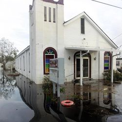 Floodwaters surround a church in the aftermath of Isaac Friday, Aug. 31, 2012, in Ironton, La. Isaac is now a tropical depression, with the center on track to cross Arkansas on Friday and southern Missouri on Friday night, spreading rain through the regions.