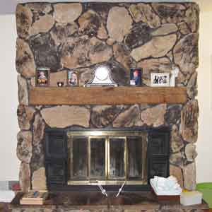 <p><strong>Shown:</strong> The fireplace's tall swath of dark faux stone dominated the room, where the only display space was the mantel shelf.</p>