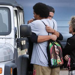 Paul Kaufusi hugs a teammate Wednesday, Sept. 25, 2013, after some of the Union High School football players where told they won't be playing in Friday's homecoming game. The football coaches at Union High in Roosevelt have taken a stand against poor performance in the classroom and bullying outside the classroom, including disrespect of teachers and students.