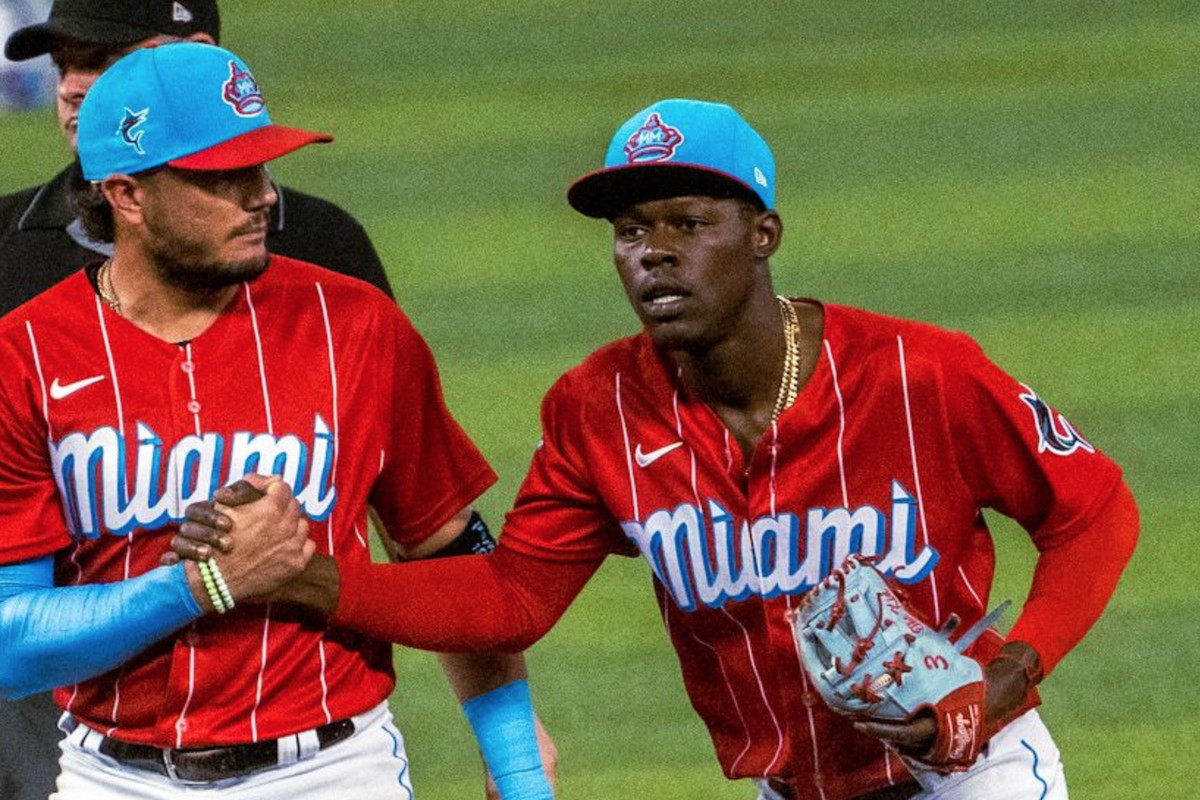 Miguel Rojas and Jazz Chisholm Jr. celebrate an out wearing the Marlins City Connect uniforms