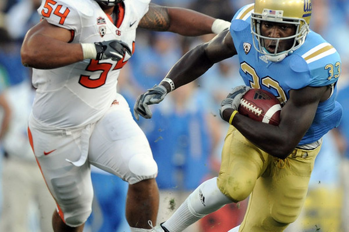 PASADENA CA - NOVEMBER 06:  Derrick Coleman #33 of the UCLA Bruins runs away from Stephen Paea #54 of the Oregon State Beavers during the second quarter at the Rose Bowl on November 6 2010 in Pasadena California.  (Photo by Harry How/Getty Images)