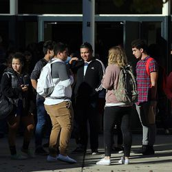 Parents and students gather outside Mountain View High School in Orem on Tuesday, Nov. 15, 2016, after five students were stabbed in an apparent attack by a 16-year-old boy.