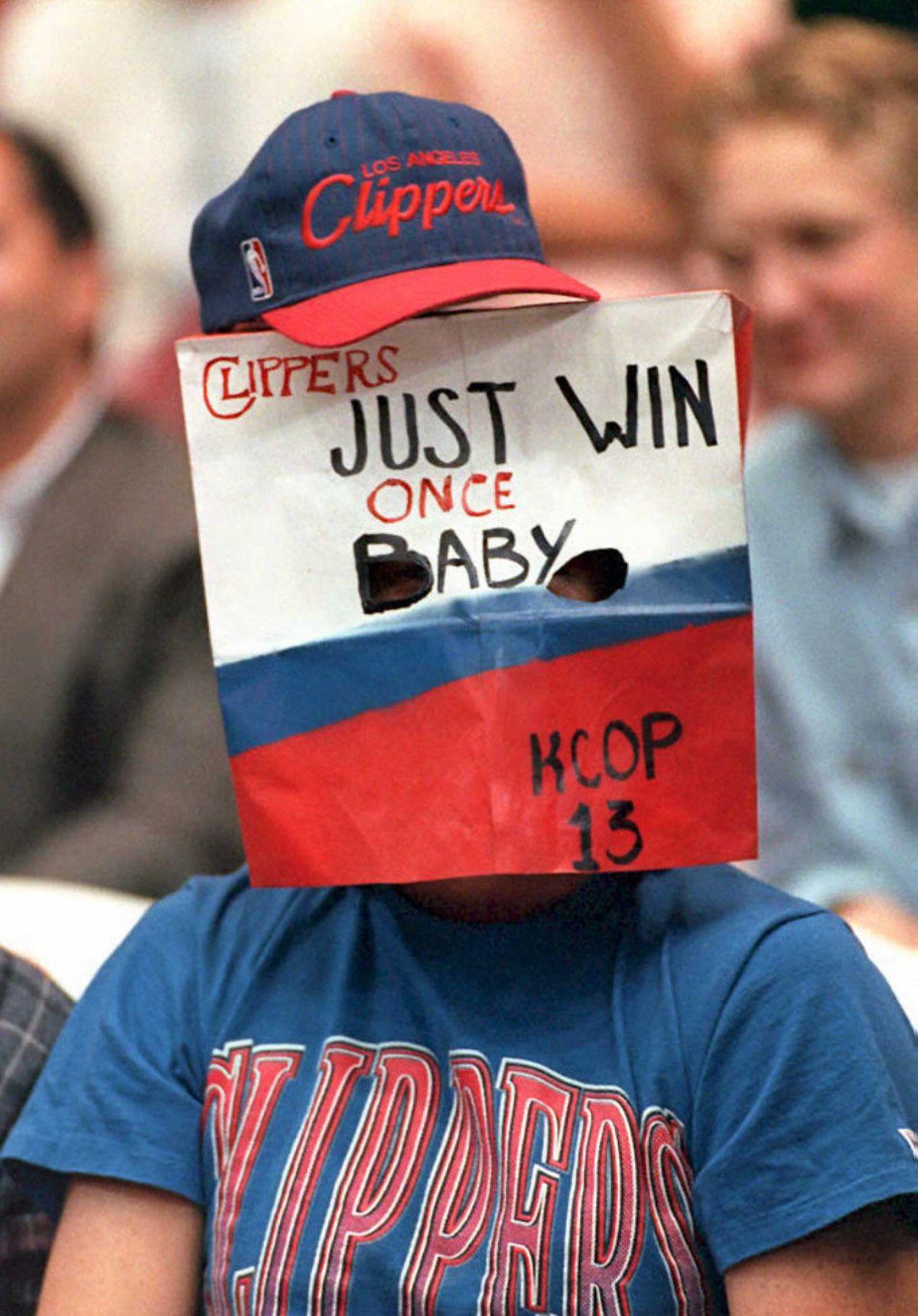 A Los Angeles Clippers basketball fan wears a bag