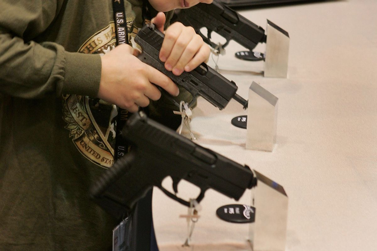 Gun enthusiasts, including children, gather at an NRA meeting.