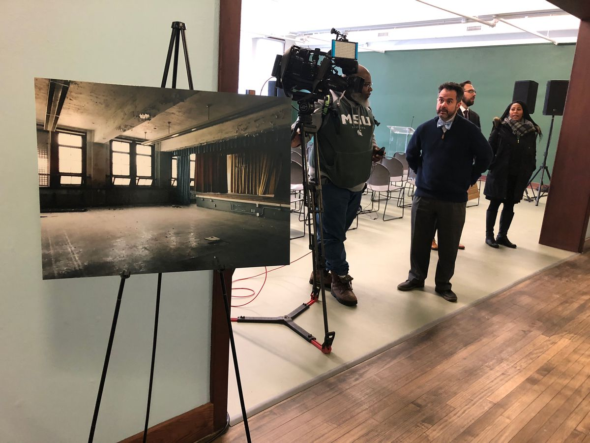 A photo on display at Detroit Prep showed the condition of the school auditorium and stage before the renovation.