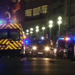 """In this video grab taken Thursday July 14, 2016, ambulances and Police cars are seen after a truck drove on to the sidewalk and plowed through a crowd of revelers who""""™d gathered to watch the fireworks in the French resort city of Nice. Officials and eyewitnesses described as a deliberate attack. There appeared to be many casualties. (BFMTV via AP)"""