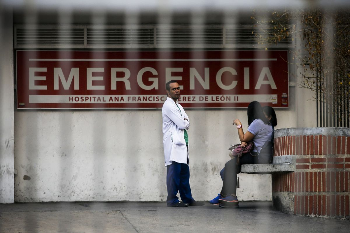 A doctor stands outside the Ana Francisca Perez de Leon hospital in Caracas on March 8, 2019.