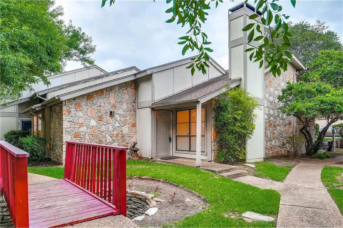 Stone building exterior, end condo unit, kind of ranch-style