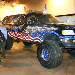 Alfonso Lima, left, and Fernando Cruz look over a Ford F-150 with a 9/11 tribute paint job, which was up for auction at the U.S. marshals auction Thursday. The marshals held an auction to sell off the $6 million worth of cars, boats and motorcycles of Jeffery Mowen, who is accused of operating a Ponzi scheme.