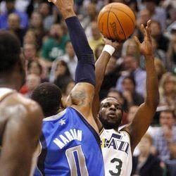 Utah Jazz forward DeMarre Carroll (3) shoots over Dallas Mavericks forward Shawn Marion (0) as the Utah Jazz and the Dallas Mavericks play Monday, April 16, 2012 in Salt Lake City.