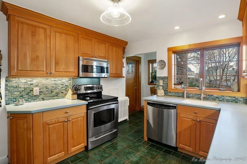 A kitchen with two counters across from each other.