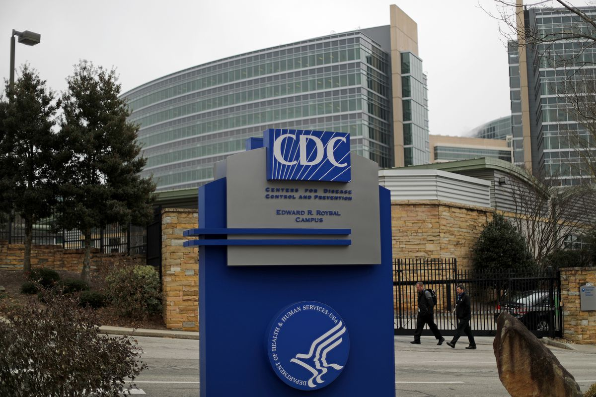 Pedestrians walk past the entrance for the U.S. Centers for Disease Control and Prevention on the third day of the government shutdown in Atlanta, Monday, Jan. 22, 2018. (AP Photo/David Goldman)