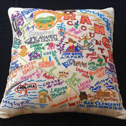 Cat Studio hand-embroidered Orange County pillow, $158