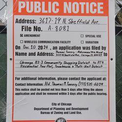 City notice posted on fence along Sheffield