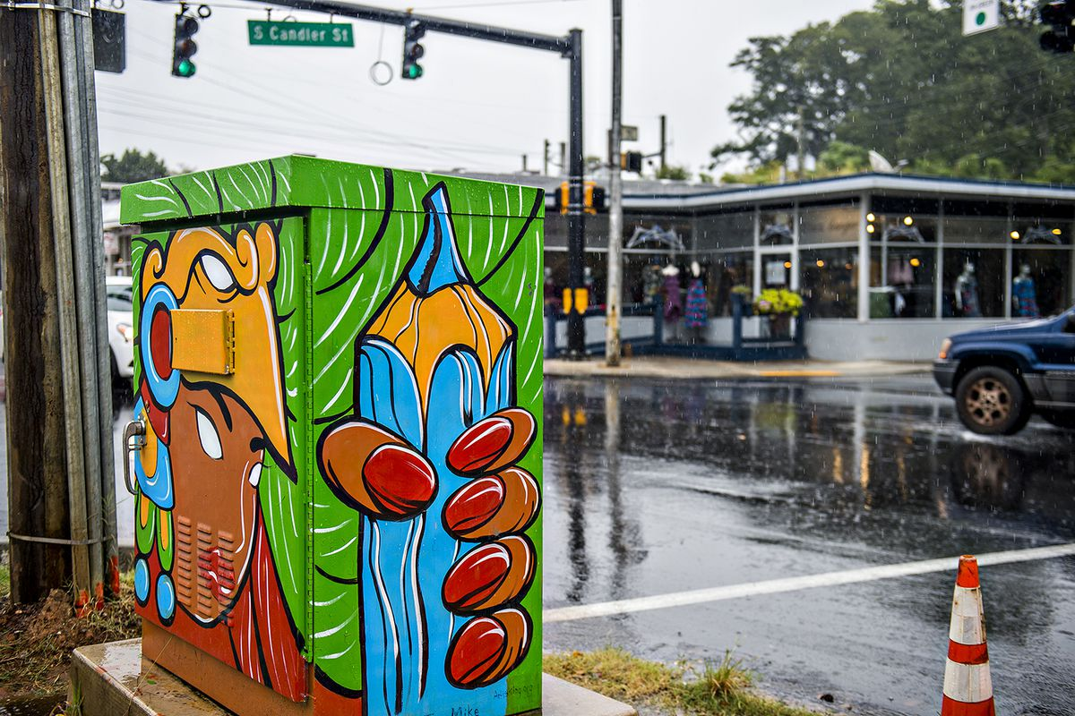 A box painted by Dan Flores in front of Bleu Hanger at the corner of East College Avenue and South Candler Street.