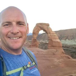 Shad Stevens takes a selfie with Delicate Arch in the background.