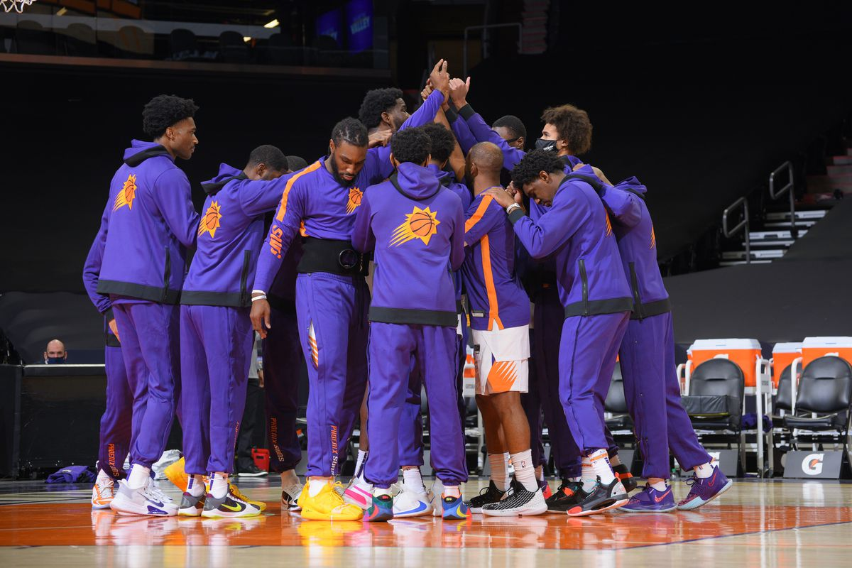 The Phoenix Suns huddle up before a preseason game against the Los Angeles Lakers on December 16, 2020 at Talking Stick Resort Arena in Phoenix, Arizona.